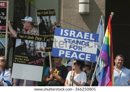 TORONTO-JULY 11: Supporters of Israel with signs saying Israel stands for peace during a rally to oppose the the Al-Quds day on July 11, 2015 in Toronto,Canada. - stock photo