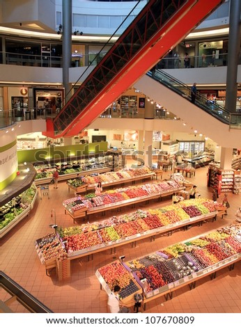 TORONTO - JULY 1: The interior of a Loblaws supermarket on July 1, 2012 in Toronto. Loblaws is a supermarket chain with over 70 stores in Canada across Ontario and Quebec. - stock photo