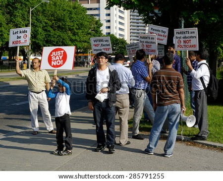 TORONTO-June 04,2015: A large group of protesters voiced their concerns with changes to the current sex ed system outside Valley Park School in Toronto - stock photo