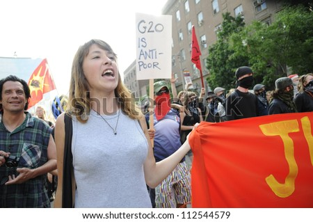 TORONTO-JUNE 25:A middle aged woman participating in a rally    during the G20 Protest on June 25  2010 in Toronto, Canada.