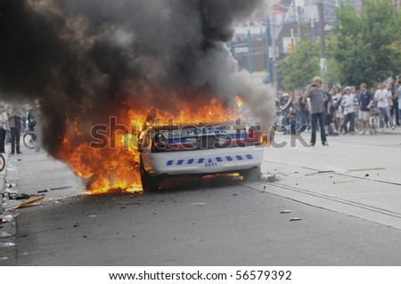 TORONTO-JUNE 26: A Police Car was torched during the G20 protest on June 26, 2010 in Toronto, Canada - stock photo
