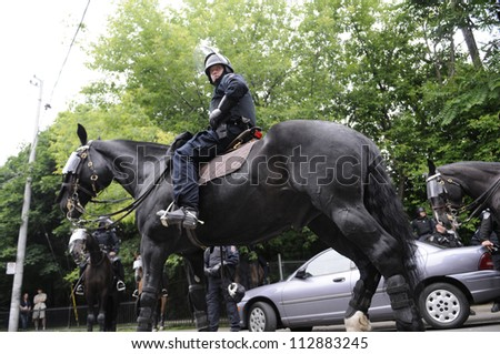 TORONTO-JUNE 27:   A police officer looks towards  the crowd during the G20 Protest on June 27, 2010 in Toronto, Canada. - stock photo
