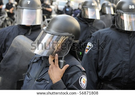 TORONTO-JUNE 25:  A Toronto Police  Sergent in riot gear listens to his radio for instructions  during the G20 Protest on June 25, 2010 in Toronto, Canada. - stock photo