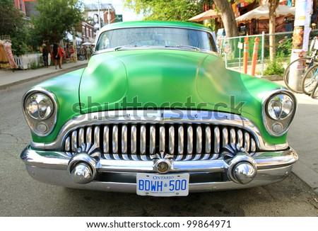 TORONTO - JUNE 19: An old green Buick on June 19, 2011 in Toronto. Buick is currently the oldest, still-active American automotive makes, and among the oldest automobile brands in the world. - stock photo