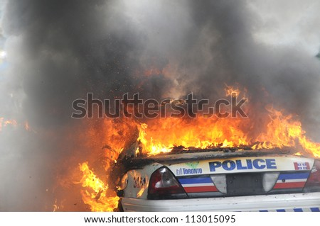 TORONTO-JUNE 26:  Back side of a  burning police car during the G20 Protest on June 26, 2010 in Toronto, Canada. - stock photo