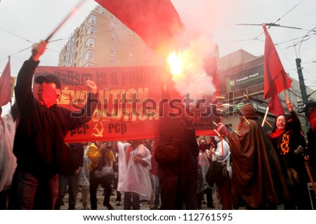 TORONTO-JUNE 26:   Black anarchists lighting fire crackers during the G20 Protest on June 26 2010 in Toronto, Canada. - stock photo