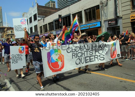 TORONTO  JUNE 29: Global Human Rights organization at World Pride Parade in June 29, 2014 in Toronto, Canada.