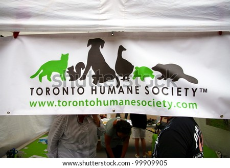 TORONTO - JUNE 12: Humane Society stand on June 12, 2011 in Toronto. Currently, 123 societies are represented at a federal level by the Canadian Federation of Humane Societies. - stock photo