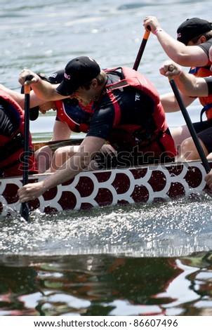 TORONTO - JUNE 21: KRG Insurance Dragon Boat racing at the21st TELUS Toronto International Dragon Boat Racing Festival at Toronto Island, June 20, 2009 Toronto, Canada - stock photo