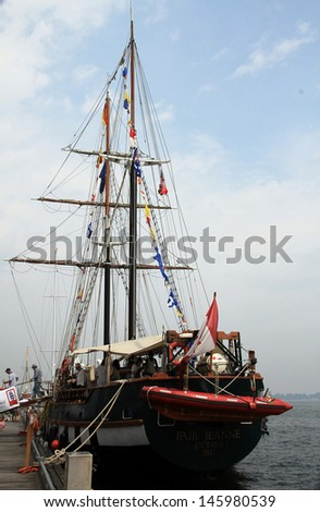 TORONTO - JUNE 22: People on the deck of sailing ship at  RedPath Waterfront Festival  - tall ships - in June 22, 2013 Toronto, Canada - stock photo