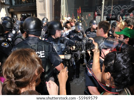 TORONTO-JUNE 25: Police and protesters clash at G20 Protest on June 25, 2010 in Toronto, Canada.
