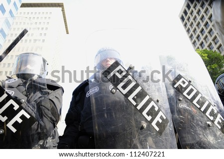 TORONTO-JUNE 25: Police in Riot gear during the G20 Protest on June 25, 2010 in Toronto, Canada. - stock photo