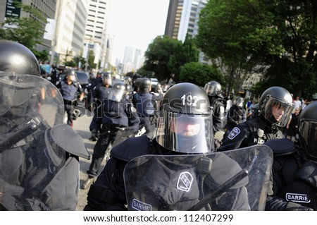 TORONTO-JUNE 25: Police in Riot gear keeping eyes on the protesters  during the G20 Protest on June 25, 2010 in Toronto, Canada. - stock photo