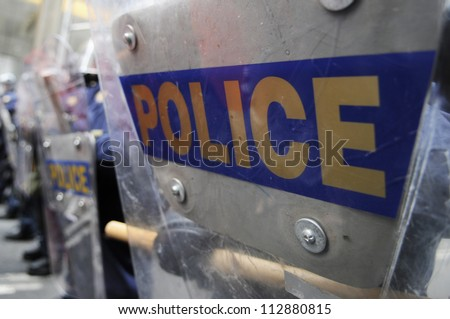 TORONTO-JUNE 26:   Police  officers blocking  protesters with their riot shield during the G20 Protest on June 26, 2010 in Toronto, Canada. - stock photo