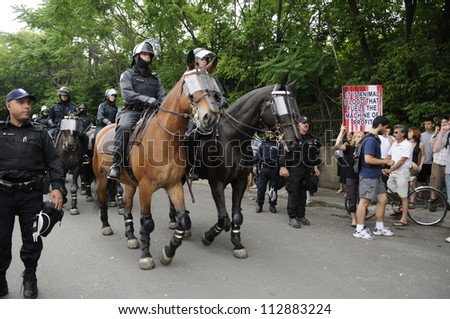 TORONTO-JUNE 27:   Police officers  marching on the streets on horses during the G20 Protest on June 27, 2010 in Toronto, Canada.