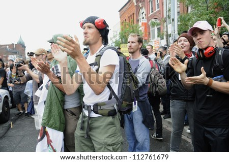TORONTO-JUNE 26:   Protester chanting slogans and clapping during the G20 Protest on June 26 2010 in Toronto, Canada. - stock photo