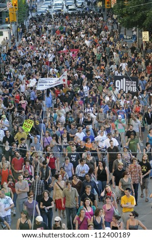 TORONTO-JUNE 28:  Protesters blocking the downtown streets during a protest rally to denounce the mass arrest of the police  after the G20 summit on June 28, 2010 in Toronto, Canada. - stock photo