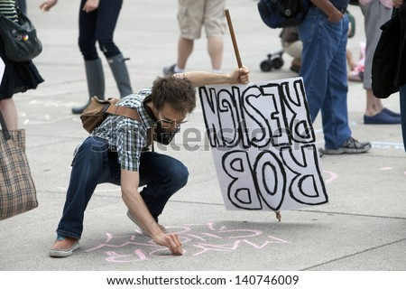 TORONTO - JUNE 1 :Protesters gathered outside Toronto city hall  and called for Mayor Rob Ford to resign due to video scandal  June 1, 2013   in Toronto, Canada. - stock photo