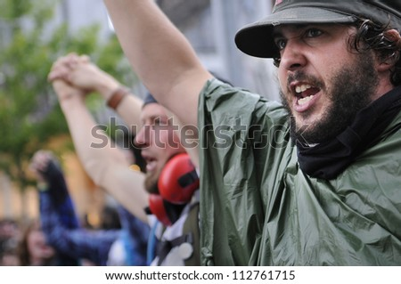 TORONTO-JUNE 26:   Protesters shouting and yelling against the police officers who didn't allow them to enter the summit area during the G20 Protest on June 26 2010 in Toronto, Canada.