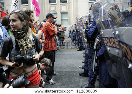 TORONTO-JUNE 26:   Protesters standing face to face with the riot police  after being not allowed to enter the summit area during the G20 Protest on June 26, 2010 in Toronto, Canada.