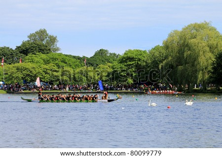 TORONTO – JUNE 26: 23rd Annual Toronto International Dragon Boat Race Festival -  in June 26 2011 on Central Island, Toronto - stock photo