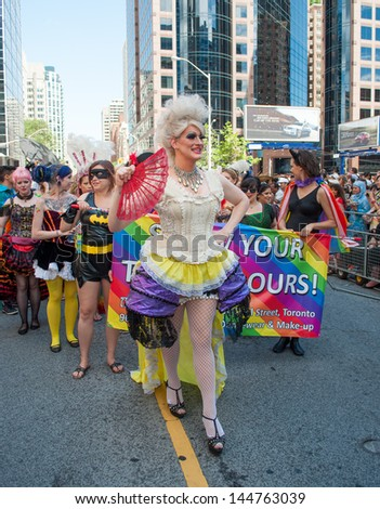 TORONTO - JUNE 30, 2013:  33rd Pride Parade which celebrates the history, courage, diversity and future of the Lesbian, Gay, and Bisexual  Allies as seen on June 30, 2013 in Toronto, Canada
