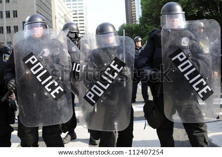 TORONTO-JUNE 25:  Riot police with protective gears during the G20 Protest on June 25, 2010 in Toronto, Canada.
