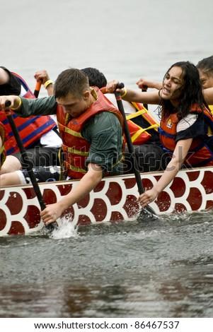 TORONTO - JUNE 20: Sir Oliver Mowet High School Dragon Boat racing at the21st TELUS Toronto International Dragon Boat Racing Festival at Toronto Island June 20, 2009 at Toronto Island, Toronto, Canada - stock photo