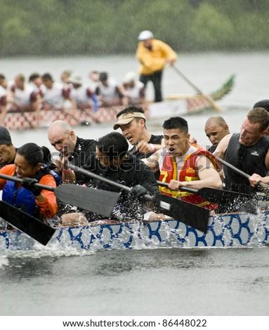 TORONTO - JUNE 20:  The MOFO Dragon Boat racing at the21st TELUS Toronto International Dragon Boat Racing Festival at Toronto Island on June 20, 2009 at Toronto Island, Toronto, Canada. - stock photo