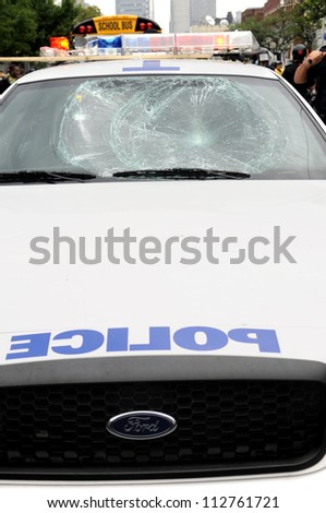 TORONTO-JUNE 26:   The windshield of a police car that got vandalized by the protesters  during the G20 Protest on June 26 2010 in Toronto, Canada.