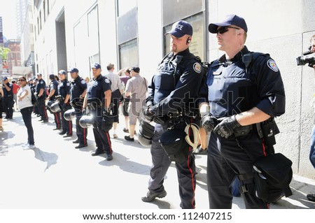 TORONTO-JUNE 25:  Toronto police forming a perimeter during the G20 Protest on June 25, 2010 in Toronto, Canada. - stock photo