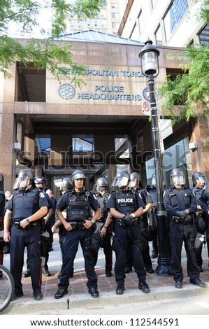 TORONTO-JUNE 28: Toronto police in front of their headquarter during  a rally to protest against the mass G20 arrest on June 28, 2010 in Toronto, Canada. - stock photo