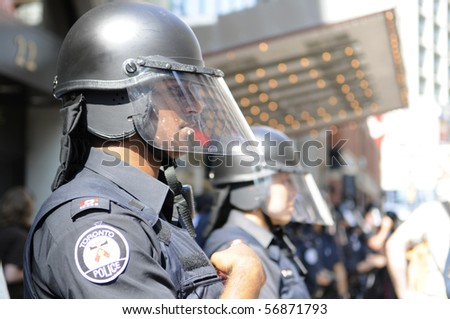 TORONTO-JUNE 25:  Toronto Police officers in riot gear during the G20 Protest on June 25, 2010 in Toronto, Canada. - stock photo