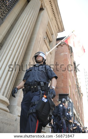 TORONTO-JUNE 25:  Toronto Police officers in riot gear marching on the streets during the G20 Protest on June 25, 2010 in Toronto, Canada. - stock photo