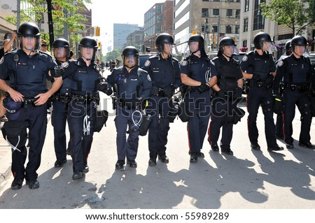 TORONTO-JUNE 25: Toronto  Police restrict protesters movement away from G20 Summit at Convention Centre on June 25, 2010 in Toronto, Canada. - stock photo