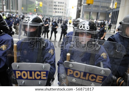 TORONTO-JUNE 26:  Toronto Riot Police  lined up on King-Bay street  during the G20 Protest on June 26, 2010 in Toronto, Canada. - stock photo