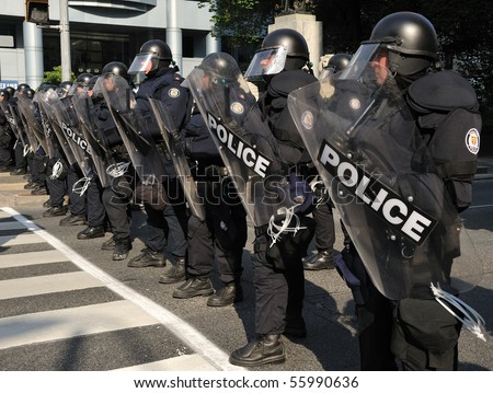 TORONTO-JUNE 25: Toronto Riot Police restrict protesters movement away from G20 Summit at Convention Centre on June 25, 2010 in Toronto, Canada. - stock photo