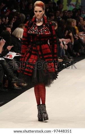 TORONTO - MARCH 12 : A model walks the runway in the Korhani Home runway show for the Fall/Winter 2012 season at Toronto's World Mastercard Fashion Week on March 12th 2012.