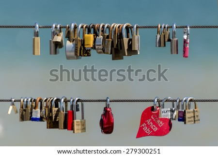 TORONTO - MAY 17: Colorful love locks attached to a bridge cable, photographed in Toronto on May 17, 2015   - stock photo