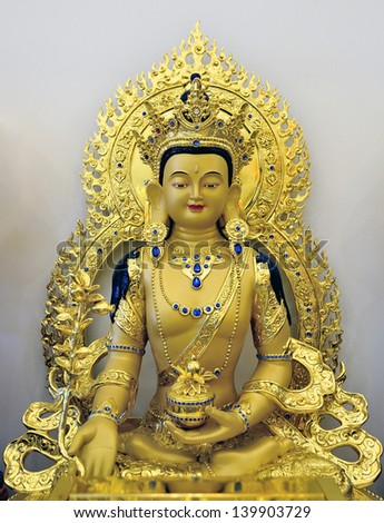 TORONTO-MAY 26: Gold plated Medicine Buddha statue in the newly opened  Jing Yin Buddhist Temple in Toronto, Canada, on May 26, 2013. - stock photo