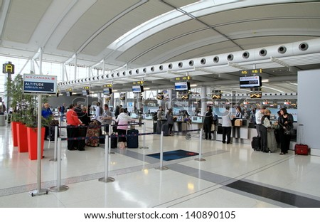 TORONTO - MAY 10: Passengers waiting to check-in on May 10, 2013 in Toronto. Pearson is the largest and busiest airport in Canada, and is one of the world's largest air transportation hubs. - stock photo