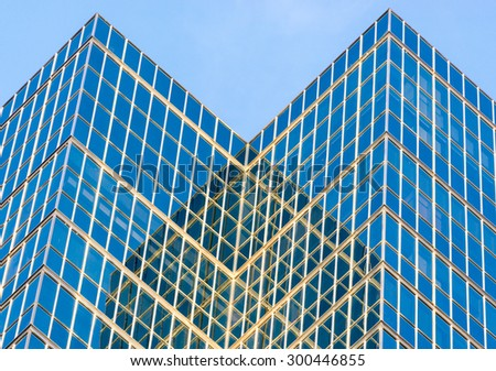 Toronto Modern architecture, abstract of modern highrise with glass walls and blue sky - stock photo