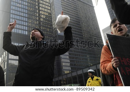 TORONTO - NOVEMBER 24: Angry occupy Toronto protesters chanting slogans in downtown Toronto during a occupy movement rally on November 24, 2011 in Toronto, Canada. - stock photo