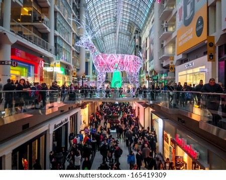 TORONTO - NOVEMBER 29: Shoppers visit the mall in Toronto, Canada on the Black Friday, November 29, 2013. - stock photo