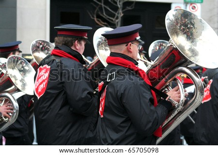 TORONTO - NOVEMBER 21: Unidentified instrumentalists at Toronto's 106th annual Santa Claus Parade on November 21, 2010 in Toronto, Canada.