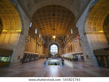 TORONTO - NOVEMBER 26: wide angle view of Toronto's Union Station main hall, on November 26, 2012. This building is one of the finest examples of Beaux Arts railway station design in Canada. - stock photo