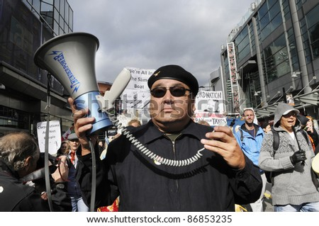 TORONTO - OCTOBER 17: An aboriginal protestor participating in a rally during the Occupy Toronto Movement on October 17, 2011 in Toronto, Canada. - stock photo