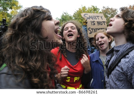 TORONTO - OCTOBER 15:  Angry protesters chanting slogans during the Occupy Toronto Movement on October 15, 2011 in Toronto, Canada. - stock photo