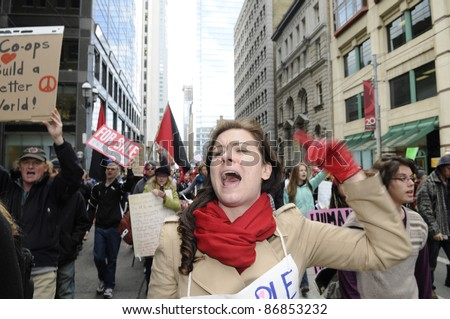 TORONTO - OCTOBER 17: Angry protestor chanting slogans while participating in a rally   during the Occupy Toronto Movement on October 17, 2011 in Toronto, Canada. - stock photo