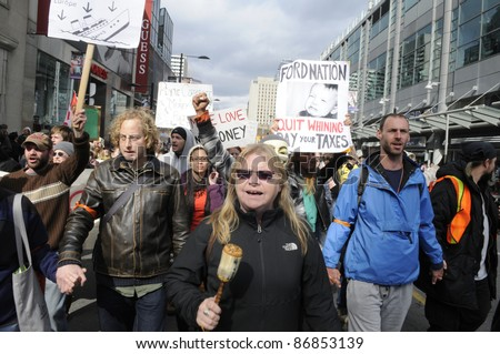 TORONTO - OCTOBER 17: Musicians and band lead a rally  during the Occupy Toronto Movement on October 17, 2011 in Toronto, Canada. - stock photo